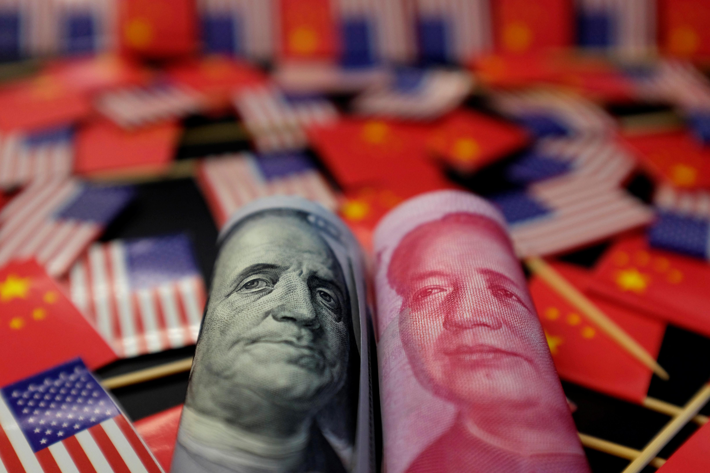 Les discussions commerciales entre les Etats-Unis et la Chine progressent dans la bonne voie et l'administration américaine espèrent parvenir à un premier accord dans le courant du mois, ont indiqué vendredi de hauts responsables américains, ce qui contribue à rassurer les marchés financiers après des mois de tractations. /Photo d'archives/REUTERS/Jason Lee