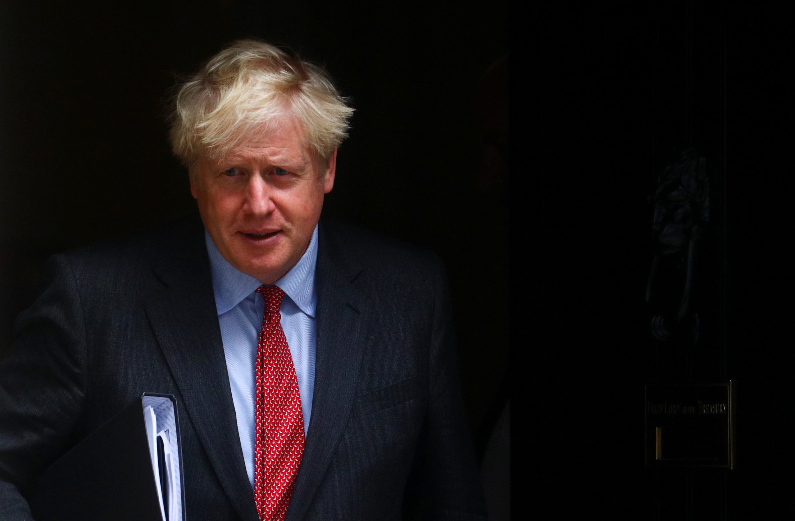 Coronavirus: Boris Johnson annonce six mois de restrictions